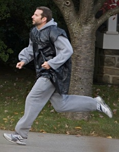 man run trash bag exercise
